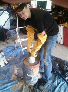 Julia removing a pipe from the mostly hardened form.