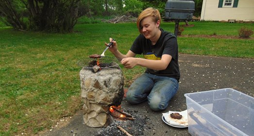 Building rocket stoves is good hard work, it's nice to take a break and fire one up for dinner. Here's Julia Dean doing exactly that!